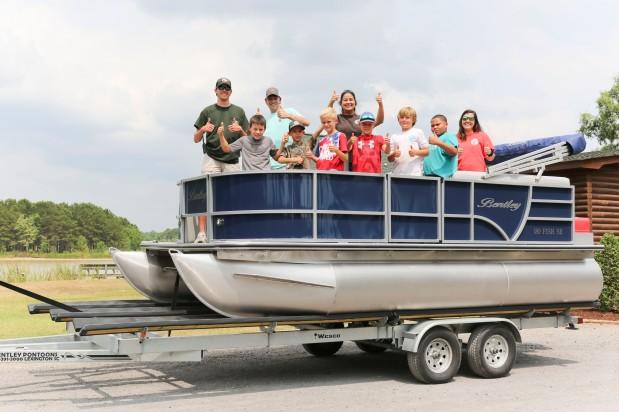 Bentley Pontoons and Suzuki donate pontoon boat andmotor